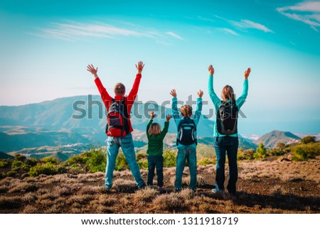 happy mom and dad with kids travel in mountains, happy family enjoy hiking #1311918719
