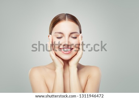 Woman relaxing. Eyes closed. Young perfect female face. Spa treatment, skincare and cosmetology concept.  #1311946472