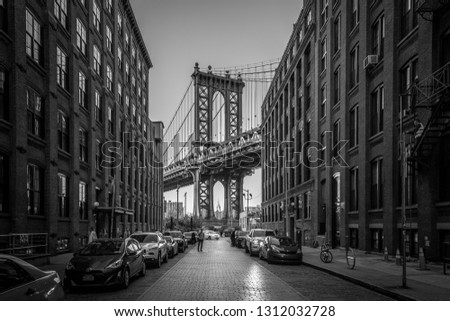 New York, United States of America - November 18, 2016: Pillar of Manhattan Bridge as seen from an alley in Dumbo district in Brooklyn #1312032728