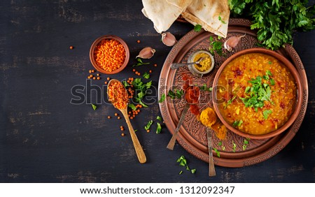 Indian dal. Food. Traditional Indian soup lentils.  Indian Dhal spicy curry in bowl, spices, herbs, rustic black wooden background. Top view. Authentic Indian dish. Overhead. Flat lay #1312092347