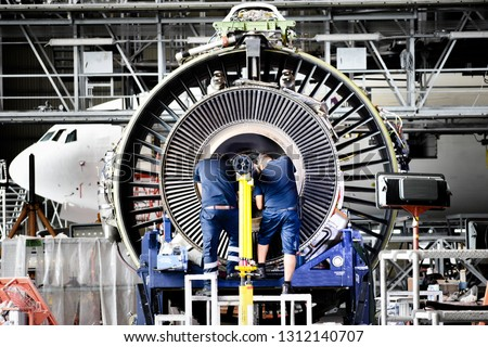 Jet engine remove from aircraft (airplane) for maintenance at aircraft hangar.Jet engine maintenance and change part by aircraft technician . #1312140707