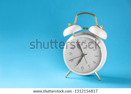 Alarm clock on color background #1312156817