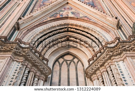 Orvieto, Italy - August 30 2018: Beautiful portal of the Italian cathedral.   #1312224089
