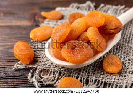 Dried apricot on dark wooden background. #1312247738