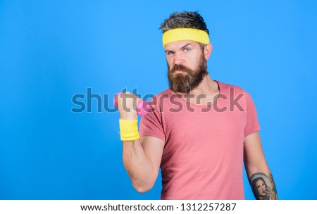 Athlete on way to stronger body. Healthy habits. Sportsman retro outfit training blue background. Athlete training with little dumbbell. Man bearded athlete exercising dumbbell. Motivated athlete guy. #1312257287