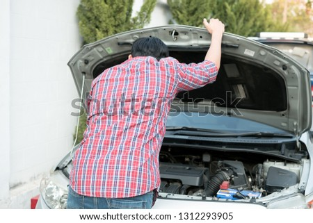 The young man stressed that there was a problem with his broken car and he was thinking of how to fix his car. #1312293905