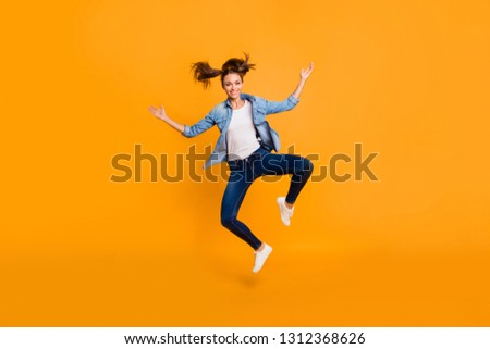 Full length body size view of nice attractive lovely adorable feminine graceful slim sporty fit cheerful cheery school girl having fun isolated over bright vivid shine yellow background #1312368626