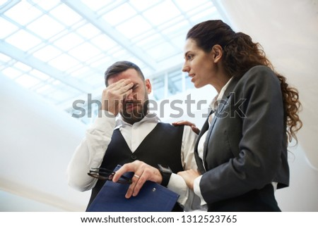 Young businesswoman comforting her upset and worried colleague while saying that it is going to be okay #1312523765