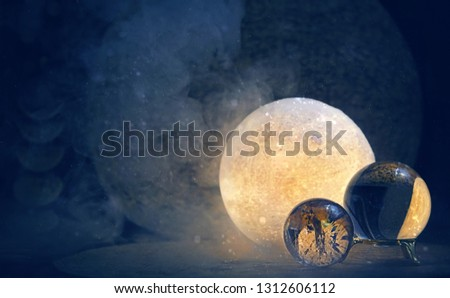 Clear quartz balls and moon lamp on dark background. Esbat, Moon Ritual, modern wiccan magic, spiritual witchcraft practice. copy space Royalty-Free Stock Photo #1312606112