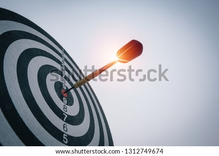Bullseye is a target of business. Dart is an opportunity and Dartboard is the target and goal. So both of that represent a challenge in business marketing as concept. #1312749674
