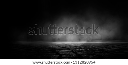 Wet asphalt, reflection of neon lights, a searchlight, smoke. Abstract light in a dark empty street with smoke, smog. Dark background scene of empty street, night view, night city. Royalty-Free Stock Photo #1312820954