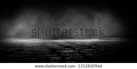 Wet asphalt, reflection of neon lights, a searchlight, smoke. Abstract light in a dark empty street with smoke, smog. Dark background scene of empty street, night view, night city. Royalty-Free Stock Photo #1312820966