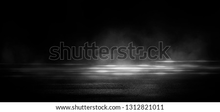 Wet asphalt, reflection of neon lights, a searchlight, smoke. Abstract light in a dark empty street with smoke, smog. Dark background scene of empty street, night view, night city. #1312821011