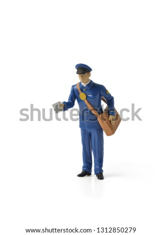 Contactless delivery. Miniature mailmen figurine presents a letter. home delivery. Keep the distance to avoid contagion. Social distance concept for epidemic safety. Covid-19 and Coronavirus