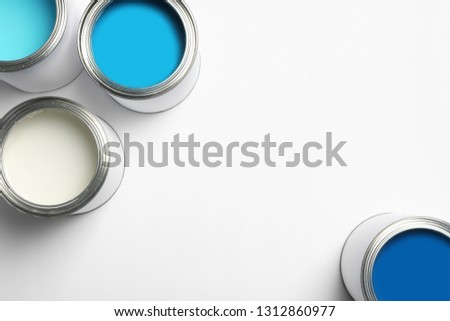 Open paint cans on white background, top view. Space for text #1312860977