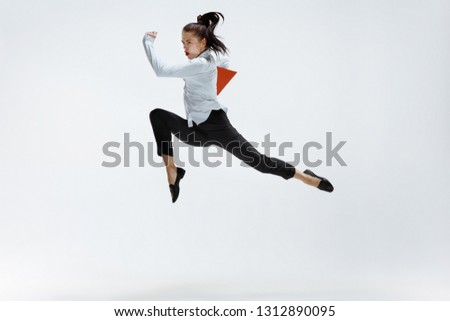 Happy businesswoman dancing and smiling in motion isolated on white studio background. Flexibility and grace in business. Human emotions concept. Office, success, professional, happiness, expression #1312890095