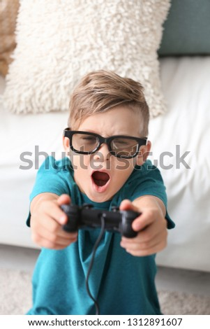 Emotional boy playing video game at home #1312891607