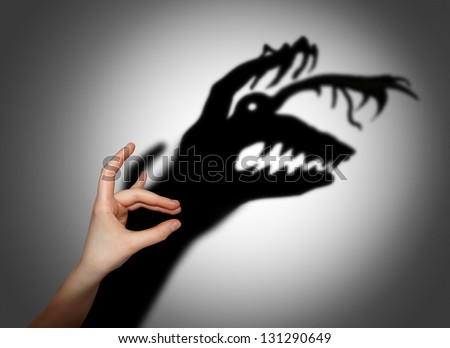 Fear, fright, shadow on the wall Royalty-Free Stock Photo #131290649