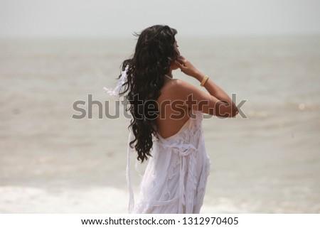 Woman at beach #1312970405