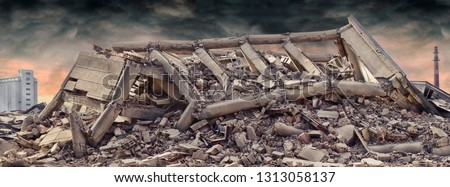 Collapsed concrete industrial building isolated on white background with dramatic sky and factory chimney and another concrete building in background. Disaster scene full of debris, dust and damaged #1313058137