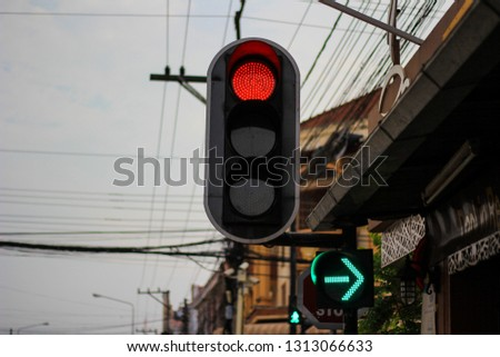 Red traffic light And the green signal to turn right #1313066633