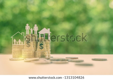Family tax benefit / residential property or estate tax concept : Family members, house, dollar money bags on rows of rising coins, depicts home equity loan, reverse mortgage, basic needs for living #1313104826