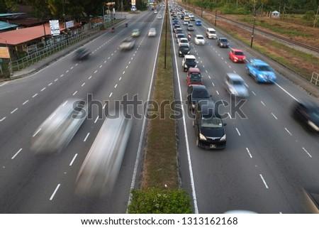 Kota Kinabalu,Sabah,MALAYSIA - FEBRUARY 14 2019 ;Road and vehicle moving back from work hours in kota kinabalu #1313162168