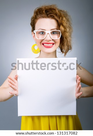 Funny woman holding empty white sign or board #131317082