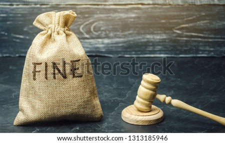 Money bag with the word Fine and the judge's hammer. Penalty as a punishment for a crime and offense. Financial punishment. Violations of traffic laws. Fraud. Fines can also be used as a form of tax #1313185946