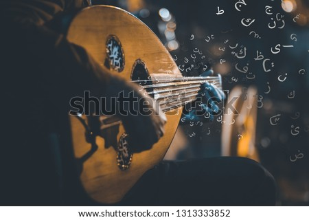 """Traditional Instrument from Middle East and Asia called Oud or Ud. A Musician Playing Note on Oud with arabic letters alphabet translation: """"a b c d e f g h""""  #1313333852"""
