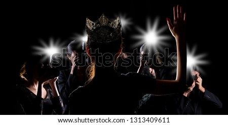 Back side view of Miss Pageant beauty contest with Silver Diamond Crown wave hand to many Photographers who shoot photo image to celebrity at red carpet event, and flash fire light came out copy space #1313409611
