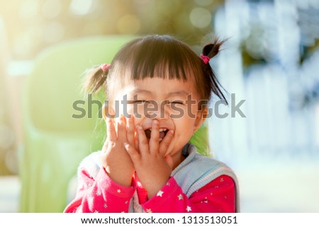 Cute asian baby girl laughing and playing peekaboo or hide and seek with fun #1313513051