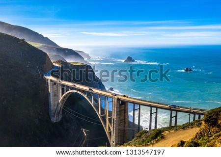 Aerial Bixby Bridge (Rocky Creek Bridge) and Pacific Coast Highway near Big Sur in California, USA America. Drone Shot Royalty-Free Stock Photo #1313547197