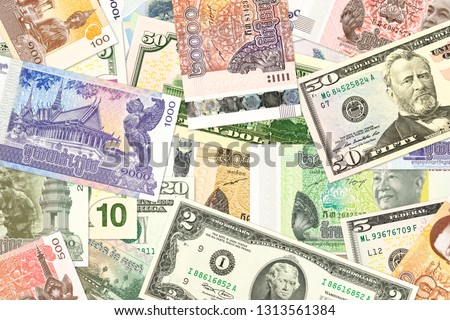 cambodian riel and us-american dollar banknotes indicating bilateral economic relations with copy space #1313561384