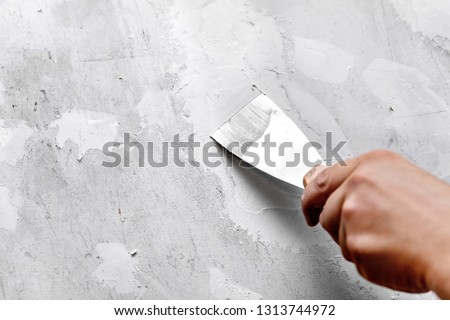 Holes and cracks in a wall are filled with filler or gypsum #1313744972