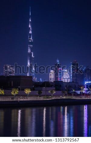 Dubai canal, UAE - Nov 16, 2018: Dubai skyline viewed from the Dubai water canal. - Image #1313792567