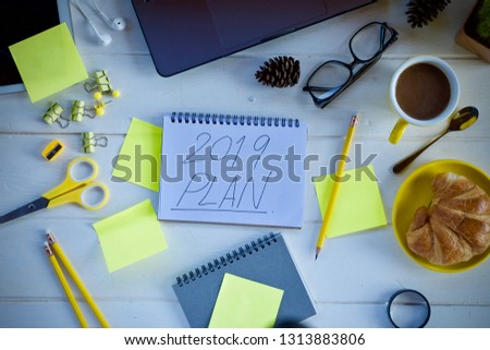 Desk work laptop notebook pen and coffee cup hot on wooden table #1313883806