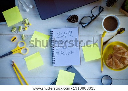Desk work laptop notebook pen and coffee cup hot on wooden table #1313883815