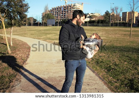 the happiness of a father with his daughter in his arms #1313981315
