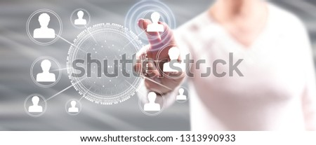 Woman touching social network on a touch screen with her fingers #1313990933