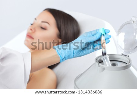 The blood tube is removed from the medical centrifuge for plasma lifting. Prp procedure. Cosmetology and skin care. #1314036086