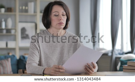 Old Senior Woman Reading Documents, Paperwork #1314043484