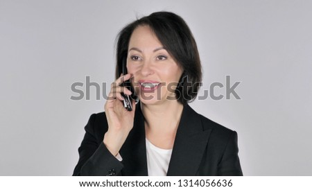 Businesswoman Talking on Smartphone with Customer #1314056636