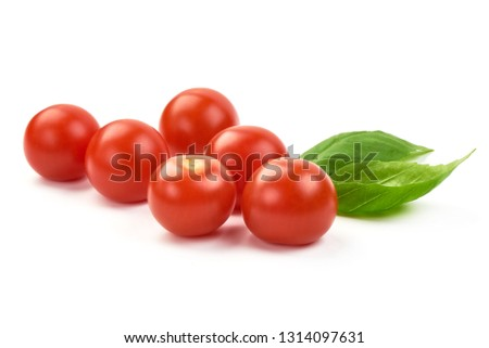 Cherry tomatoes with basil, close-up, isolated on white background. #1314097631