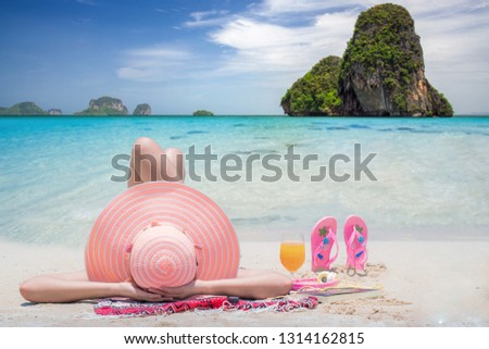 Lady relax on the Thailand beach, Krabi is travel point near Phuket, this photo can use for travel, summer, holiday, island and vacation #1314162815