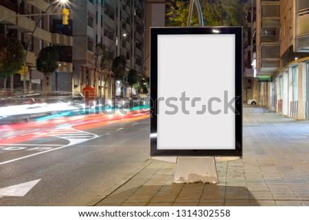 Blank advertisement billboard, with blurred traffic lights at night #1314302558