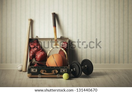 Old Suitcase with sports equipment Royalty-Free Stock Photo #131440670