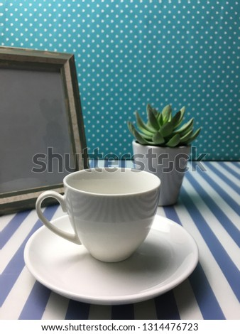 White cup on the table,mug #1314476723