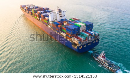 Container ship arriving in port, container ship and tug boat going to sea port, logistic business import export shipping and transportation, Aerial view. #1314521153