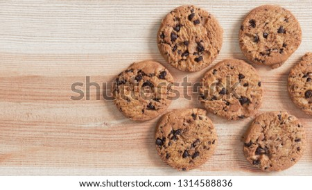 Chocolate chip cookies on the wood table. Copy space for your text or image. #1314588836